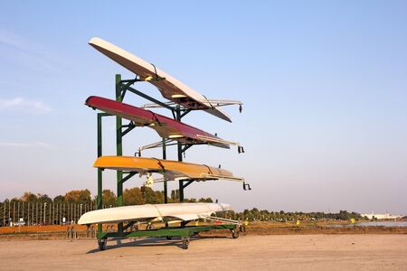 rower: Four rowing boats standing on metal stand Stock Photo