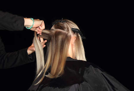 Blonde young woman in hair salon photo