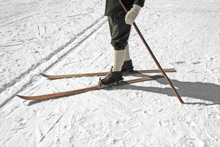 Old wooden skis and leather ski boots