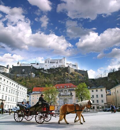 SALZBURG   AUSTRIA - APRIL 16  Horse-drawn carts in the city center April 16, 2006 in Salzburg  In the background of an old fortress