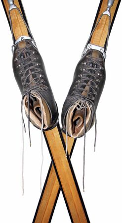 Old leather shoes on wooden skis isolated on white background