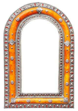 Antique Moroccan silver mirror frame isolated on white background photo