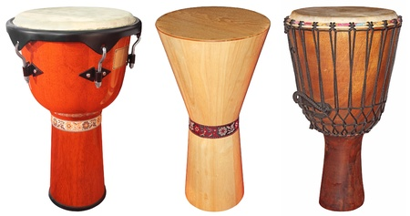 Three wooden jembe drums isolated on white background Stockfoto