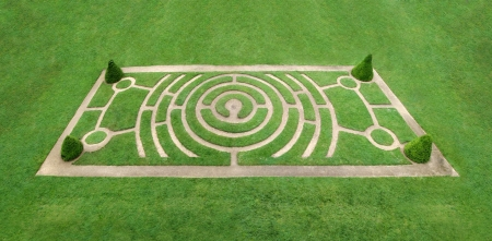 labyrinthine: Circular labyrinth as a walking trail in the grass Stock Photo