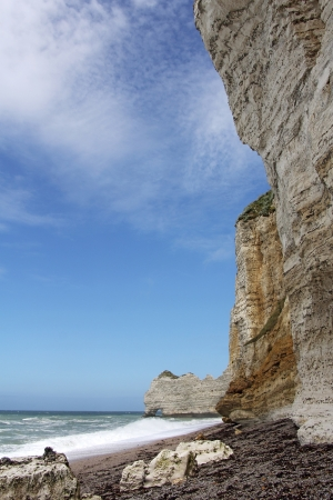 rock arch: Etretat, natural rock arch wonder, cliff and beach  Normandy, France