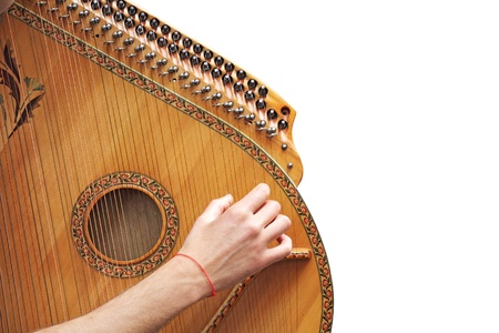 Man playing medieval lute, isolated on white background photo