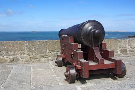 ramparts: Old cannon along the wall of St Malo ramparts Stock Photo