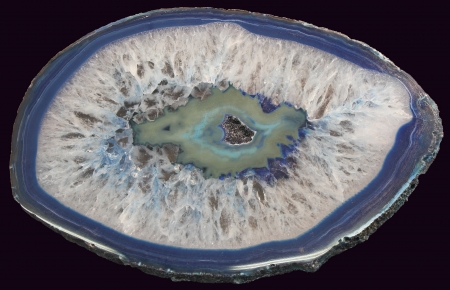 chalcedony: cross section of blue agate isolated on black background