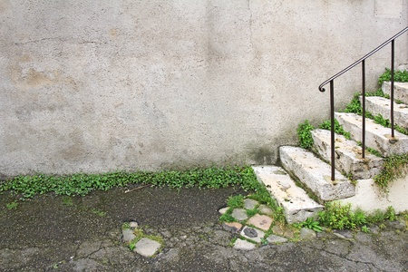 Old damaged stone staircase and old damaged wall photo