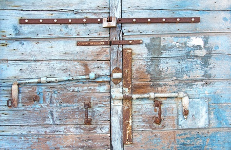 old iron, rusty latch on the old wooden door photo