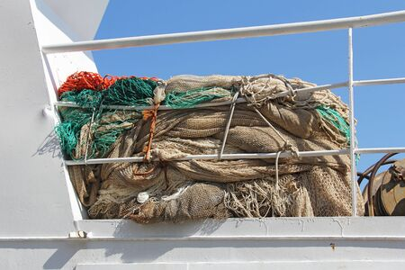 fishing nets on a white boat for fishing photo