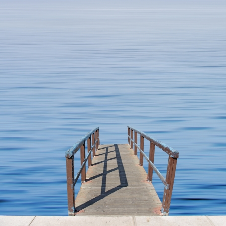 Small wooden while over calm blue sea photo