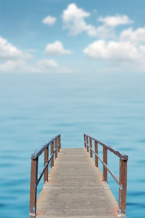 the long lake: Small wooden while over calm turquoise blue sea Stock Photo