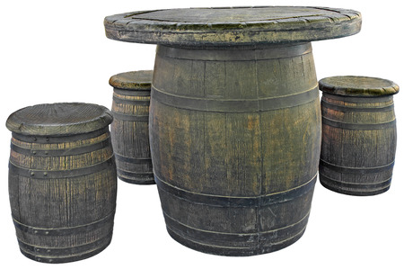 Old wooden barrels used as tables and chairs photo