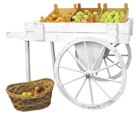 a two wheeled vehicle: Old wooden cart with apples isolated on white background