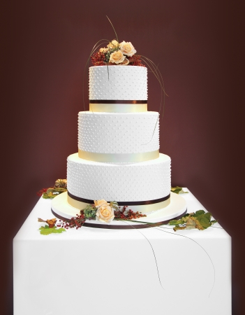 Big white wedding cake decorated with flowers Stock fotó