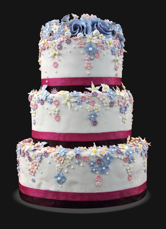 Big white wedding cake decorated with flowers photo