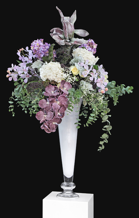 Bouquet of flowers in a vase and a black background photo