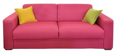 Red two-seat sofa with pillows, isolated on white background photo