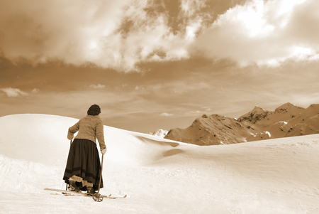 Female Skier in a skirt and old wooden skis photo