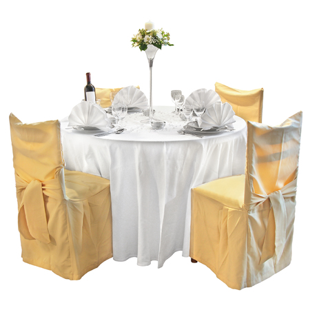 wedding chairs: Table with utensils decorated with vases of flowers