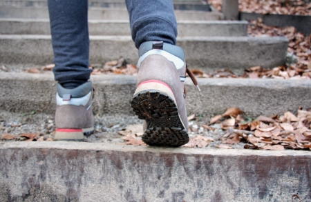 ascend: Young girl climbs on concrete stairs Stock Photo