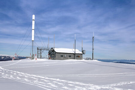Weather station on the mountain, winter and snow, Gerlitzen, Austria photo