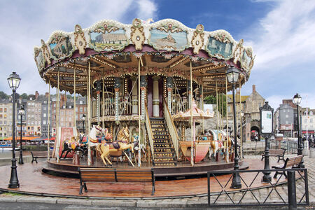 carrousel: Old wooden carousel in Honfleur, a small medieval harbor in Normandy, France Stock Photo
