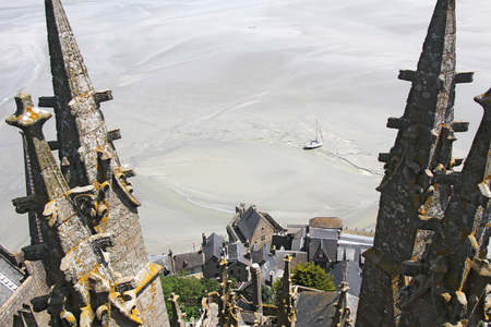 View from the tower of the abbey Mountain Saint Michel, stranded boat at low tide photo