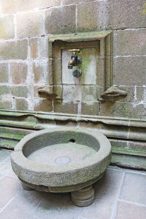 Large water tap in the monastery Mont Saint Michel, Normandy, France  photo