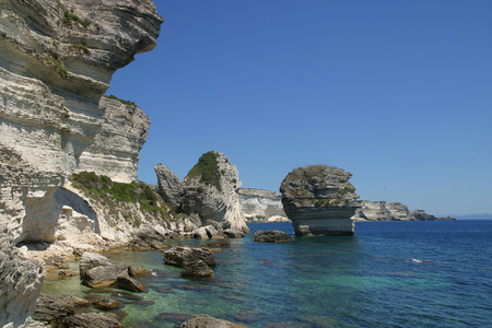 Coast and cliffs near old town Bonifacio, Corsica photo