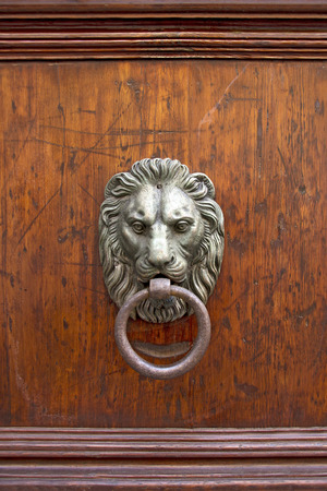 rom: Old Door knoker handle in the form of a lion Stock Photo