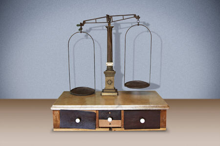 Old pharmaceutical scales with two wooden drawers photo