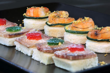 party with food: Assorted canape with shrimp and zucchini, homemade party food Stock Photo