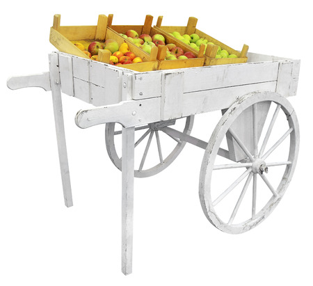 a two wheeled vehicle: Apples on a white wooden cart