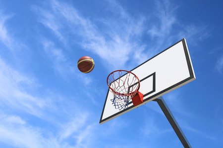 outdoor basketball court: Basketball backboard and blue sky