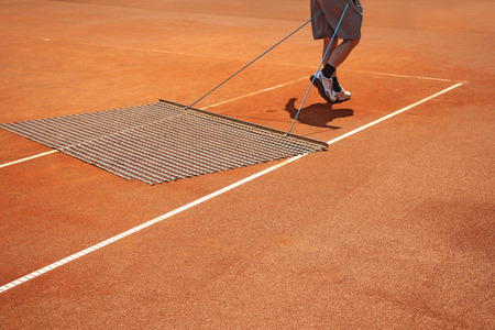 aligning: Aligning surface tennis court, with pulling network  Stock Photo