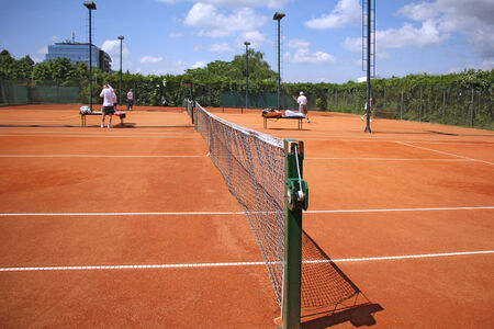 Tennis courts and play pairs, on a nice sunny day  photo