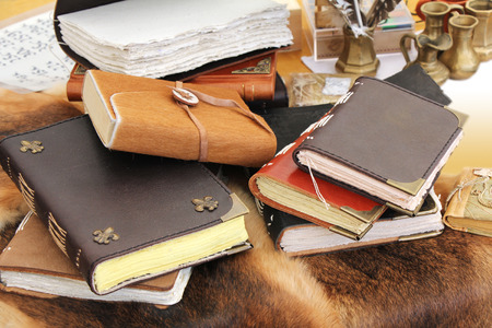 annals: Old books and inkstand on the fur leather