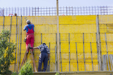 Two Bricklayer or builder or worker build on construction or building site  photo
