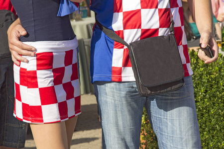 Young couple in traditional uniform of Croatian football fans  photo