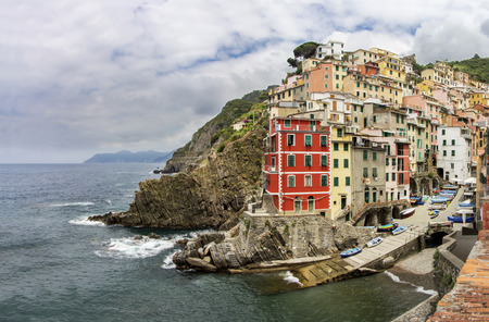 italian village: Riomaggiore fisherman village, is one of five famous colorful villages of Cinque Terre in Italy