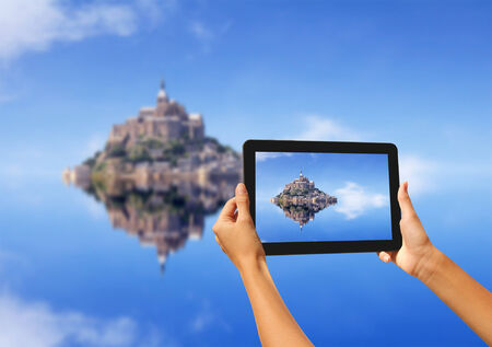michel: Girl taking pictures on a tablet, Le Mont Saint Michel Abbey, Normandy   Brittany, France Stock Photo