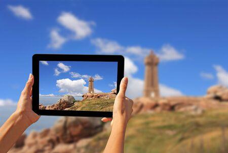 stone tablet: Girl taking pictures on a tablet Pors Kamor lighthouse, Ploumanac