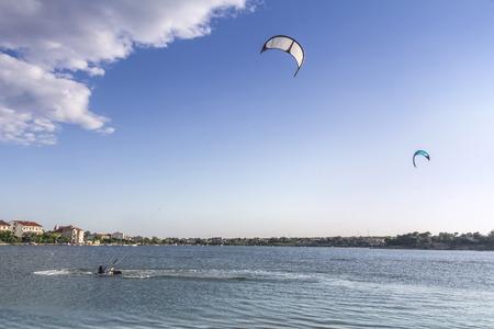 kiteboarding: Kiteboarding, kitesurfing, many kites in the sky, Nin, Croatia