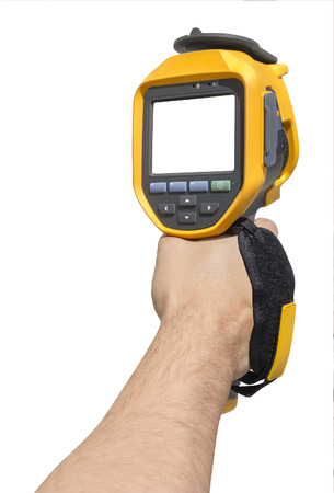 thermography: Man hand holding a thermal camera isolated on white background with Clipping Path