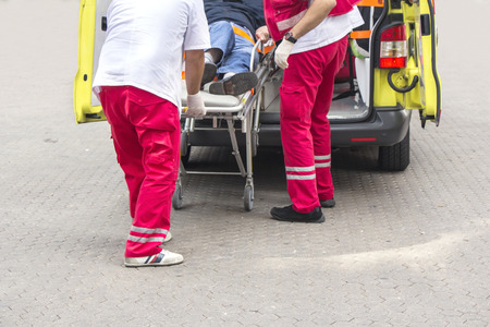 wounded heart: Paramedics rushing patient into an ambulance