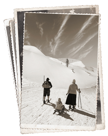 Vintage photos with Man and woman with old wooden skis and child on sled photo