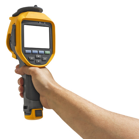 heat radiation: Man recording with a thermal camera isolated on white background with Clipping Path