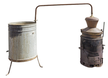 obtain: Old Copper boiler used to obtain a traditional brandy, isolated with Clipping Path